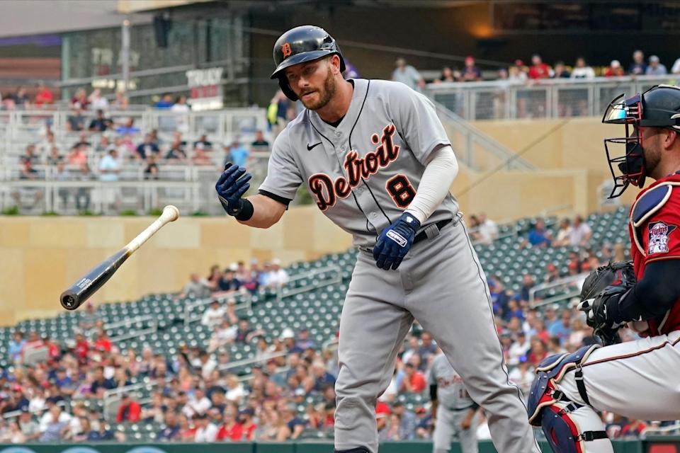 Detroit Tigers' Robbie Grossman (8) tosses his bat after he drew a walk off Minnesota Twins pitcher Kenta Maeda during the first inning of a baseball game Tuesday, July 27, 2021, in Minneapolis.