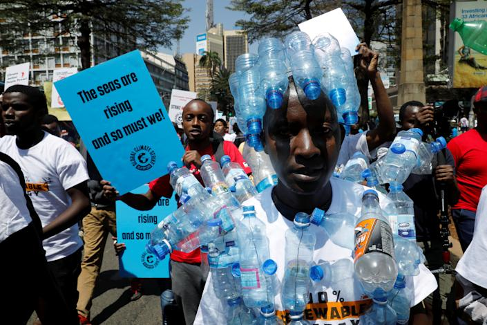 An environmental activist holds a sign as he takes part in the Climate strike protest calling for action on climate change, in Nairobi, Kenya, September 20, 2019. (Photo: Baz Ratner/Reuters)