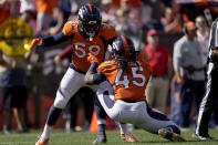 Denver Broncos linebacker A.J. Johnson (45) celebrates his sack against the New York Jets with linebacker Malik Reed (59) during the first half of an NFL football game, Sunday, Sept. 26, 2021, in Denver. (AP Photo/David Zalubowski)