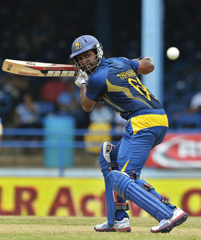 Sri Lankan batsman Lahiru Thirimanne plays a shot during the final match of the Tri-Nation series between India and Sri Lanka at the Queen's Park Oval stadium in Port of Spain on July 11, 2013. India won the toss and elected to field first. AFP PHOTO/Jewel Samad
