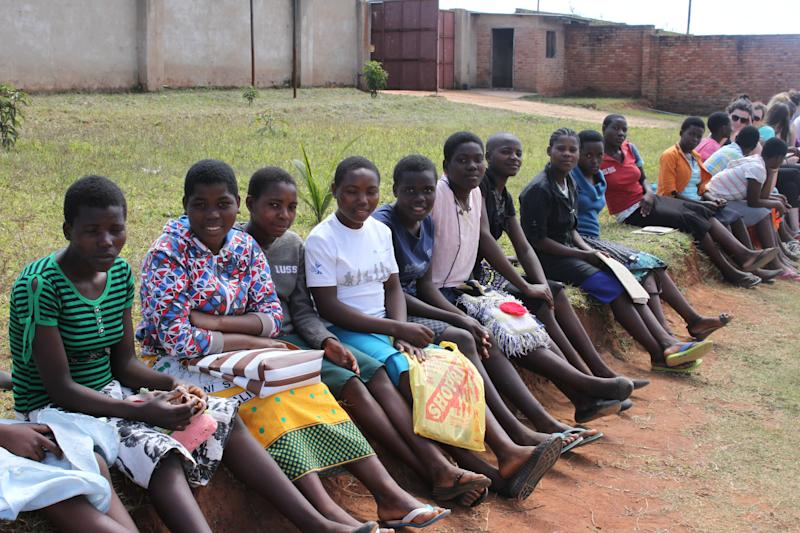 Secondary school girls who are part of the Girl Child Student program take a break from their studies. (Wells for Zoë/Flickr)