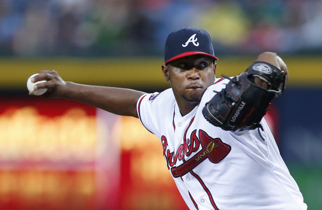Atlanta Braves starting pitcher Julio Teheran delivers in the first inning of a baseball game against the Chicago Cubs, Friday, May 9, 2014, in Atlanta. (AP Photo/John Bazemore)