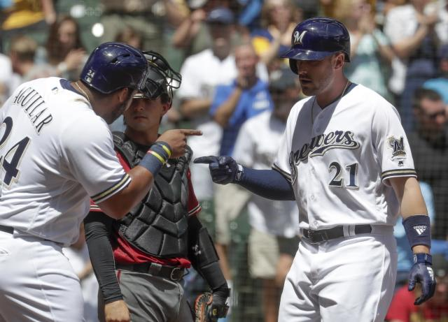Milwaukee Brewers' Jesus Aguilar congratulates Travis Shaw (21) after his three-run home run during the fourth inning of a baseball game against the Arizona Diamondbacks Wednesday, May 23, 2018, in Milwaukee. (AP Photo/Morry Gash)