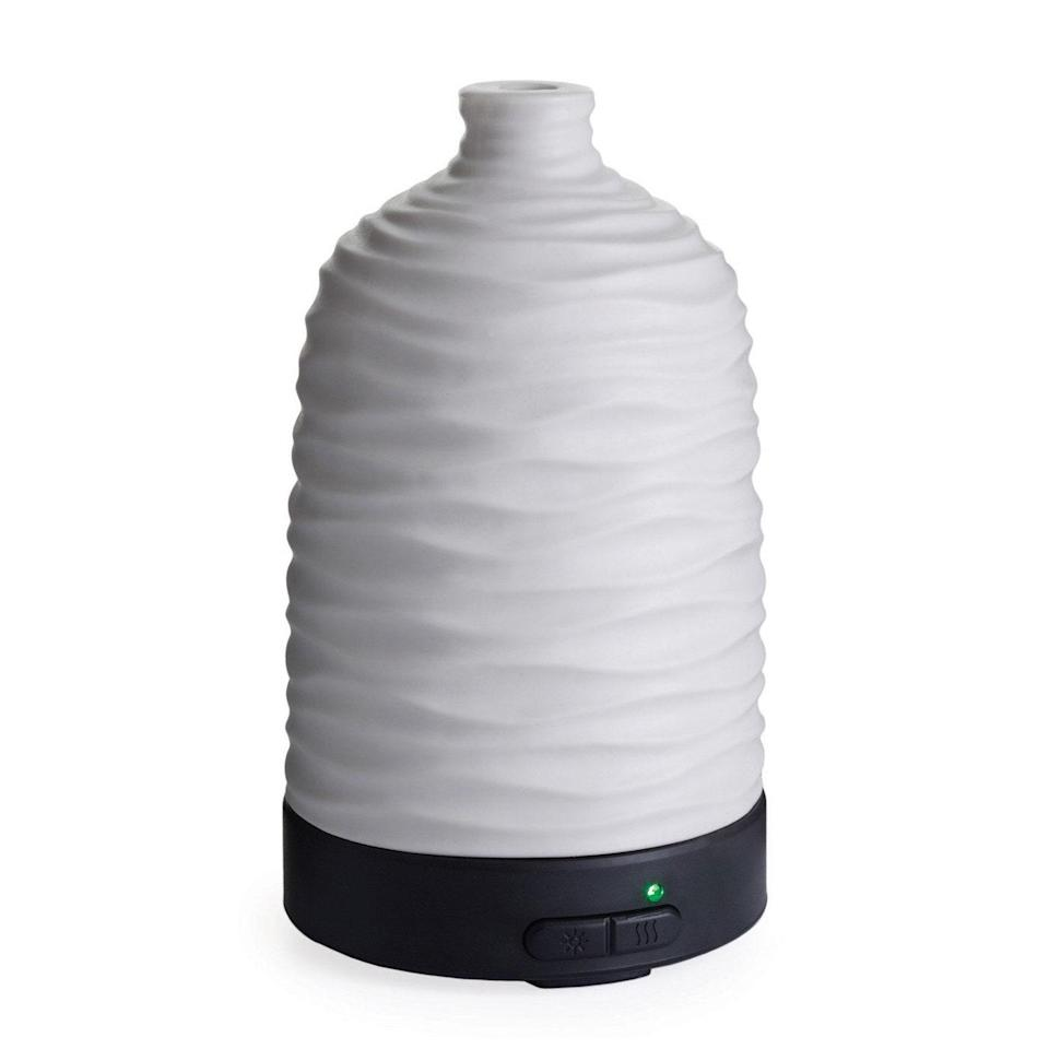 """<p>Due to its silent ultrasonic diffusion method and its white ceramic exterior, the Airome Ultrasonic Harmony Diffuser is both quieter and more attractive than most other models. According to reviewers, it's surprisingly small (holding about one cup of water), yet """"<a href=""""https://www.target.com/p/essential-oil-diffuser-airome-ultrasonic-diffuser-harmony-candle-warmers-etc/-/A-52337048?showOnlyReview=true#"""" rel=""""nofollow noopener"""" target=""""_blank"""" data-ylk=""""slk:puts out a nice amount of oil"""" class=""""link rapid-noclick-resp"""">puts out a nice amount of oil</a>"""" and """"lasts most of the day.""""</p> <p><strong>$33</strong> (<a href=""""https://shop-links.co/1712737145951546700"""" rel=""""nofollow noopener"""" target=""""_blank"""" data-ylk=""""slk:Shop Now"""" class=""""link rapid-noclick-resp"""">Shop Now</a>)</p>"""