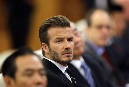 Former captain of England soccer team David Beckham attends a ceremony at the Great Hall of the People in Beijing April 21, 2014. REUTERS/Jason Lee