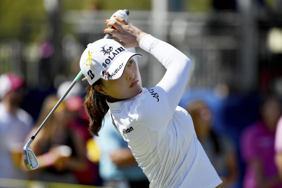 Jin Young Ko, of South Korea, watches het tee shot on the 17th hole during the final round of the LPGA Arkansas Championship golf tournament, Sunday, Sept. 26, 2021, in Rogers, Ark. (AP Photo/Michael Woods)