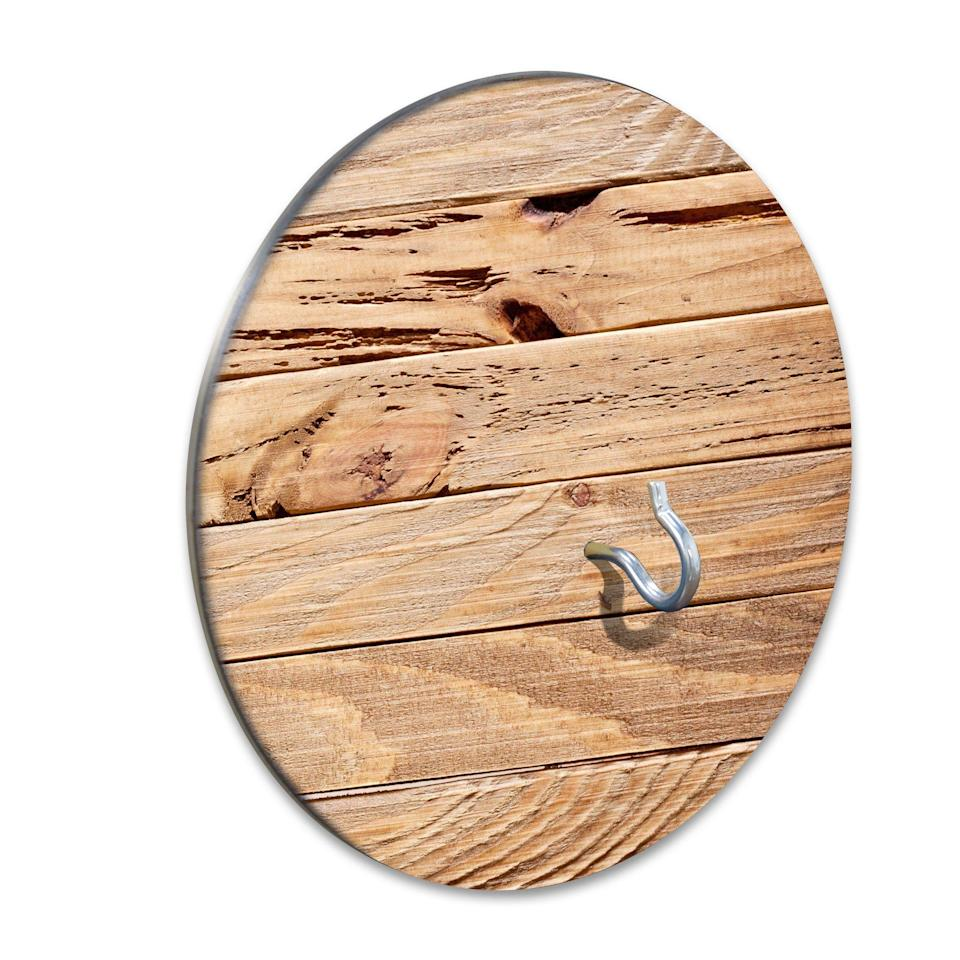 """<p>slickwoodys.com</p><p><strong>$35.00</strong></p><p><a href=""""https://www.slickwoodys.com/collections/portable-fire-pits/products/country-living-rustic-ash-wood-hook-ring-game"""" rel=""""nofollow noopener"""" target=""""_blank"""" data-ylk=""""slk:Shop Now"""" class=""""link rapid-noclick-resp"""">Shop Now</a></p><p>Warning: You will lose hours of your life trying to swing a string and its ring (also included) onto this tiny hook, but it's wildly satisfying when you do it. (Bonus: As far as backyard games go, this one takes up minimal space.)</p>"""