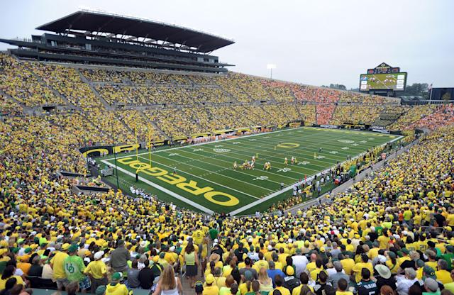 A general view of the crowd at Autzen Stadium during the third quarter of the NCAA college football game between the Oregon and the Tennessee in Eugene, Ore., Saturday, Sept. 14, 2013. Oregon won the game 59-14. (AP Photo/Steve Dykes)