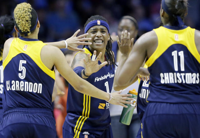Indiana Fever guard Shavonte Zellous, center, celebrates with guard Layshia Clarendon, left, and forward Karima Christmas during the first half in Game 1 of the WNBA basketball Eastern Conference semifinal series against the Chicago Sky on Friday, Sept. 20, 2013, in Rosemont, Ill. (AP Photo/Nam Y. Huh)