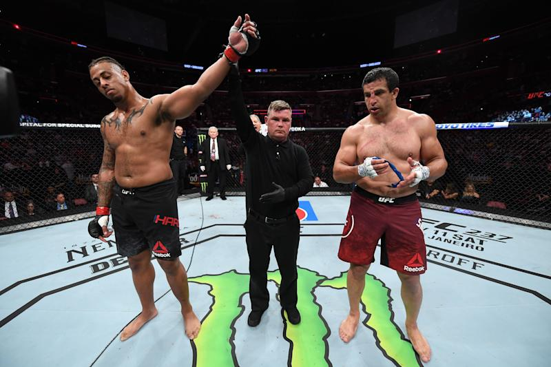 SUNRISE, FL - APRIL 27: (L-R) Greg Hardy celebrates his victory over Dmitrii Smoliakov of Russia in their heavyweight bout during the UFC Fight Night event at BB&T Center on April 27, 2019 in Sunrise, Florida. (Photo by Jeff Bottari/Zuffa LLC/Zuffa LLC via Getty Images)