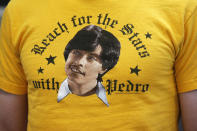 """In this May 3, 2019, photo, a fan wears a Pedro shirt during a photo-op with cast members of """"Napoleon Dynamite,"""" as they celebrate the 15th anniversary of the cult classic comedy, in Salt Lake City. (AP Photo/Rick Bowmer)"""