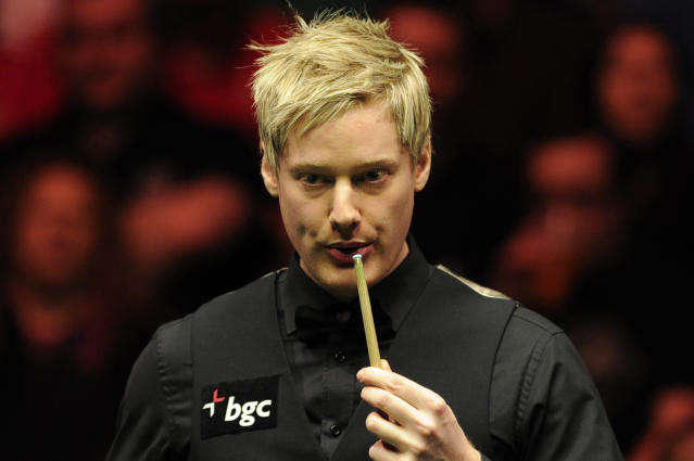 Neil Robertson of Australia blows chalk from his cue tip during the semi-final match against Judd Trump of England in the BGC Masters snooker tournament at Alexandra Palace in north London on January 21, 2012. Robertson went on to win the match 6-3. AFP PHOTO / CARL COURT (Photo credit should read CARL COURT/AFP/Getty Images)
