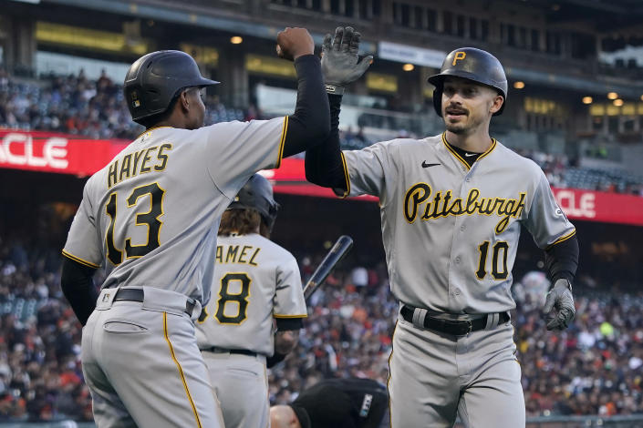 Pittsburgh Pirates' Bryan Reynolds (10) celebrates after hitting a two-run home run that scored Ke'Bryan Hayes (13) during the third inning of the team's baseball game against the San Francisco Giants in San Francisco, Friday, July 23, 2021. (AP Photo/Jeff Chiu)