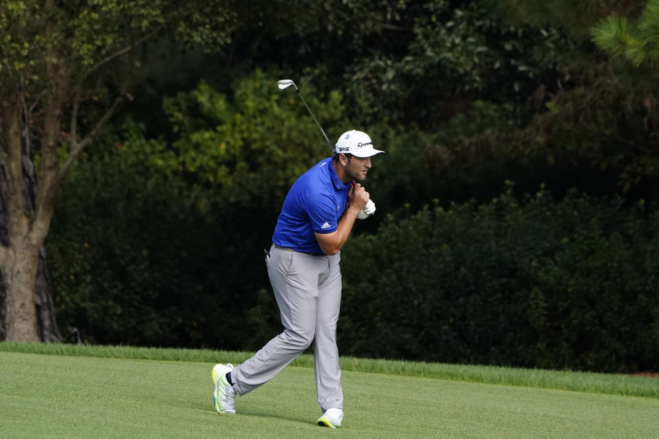 Jon Rahm, of Spain, checks his shot on the second fairway during the third round of the Masters golf tournament Saturday, Nov. 14, 2020, in Augusta, Ga. (AP Photo/Matt Slocum)