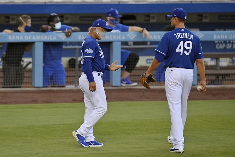 Dodgers manager Dave Roberts, left, talks with relief pitcher Blake Treinen during an intrasquad game.