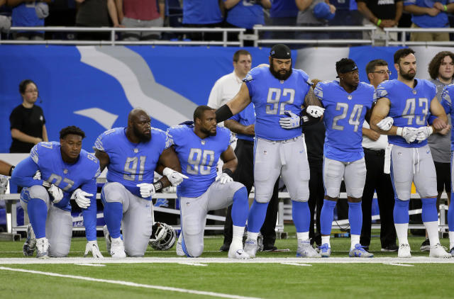 <p>Detroit Lions defensive end Armonty Bryant (97), defensive tackle A'Shawn Robinson (91) and defensive end Cornelius Washington (90) take a knee during the national anthem before an NFL football game against the Atlanta Falcons, Sept. 24, 2017, in Detroit. (Photo: Duane Burleson/AP) </p>
