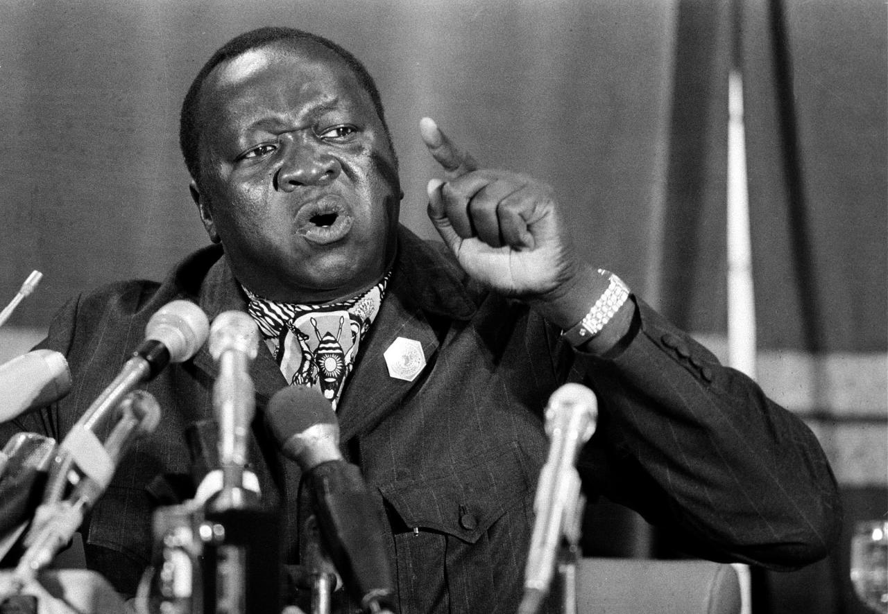 FILE - In this March 8, 1977 file photo President of Uganda Idi Amin is shown at a news conference at the Arab League Headquarters in Cairo, Egypt. Former Liberian President Charles Taylor is part of a long parade of leaders guilty or accused of similar, and in some cases far more appalling, crimes in modern history. Here is what happened to some: Idi Amin: Uganda's deposed dictator lived in exile in Saudi Arabia until his death at around the age of 80 in 2003. His regime was notorious for torturing and killing suspected opponents in the 1970s. His cruel, extravagant ways led to social disintegration and economic decline in his landlocked country. (AP Photo/Horst Faas, File)