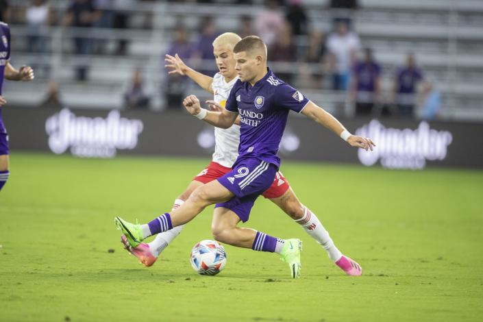 Orlando City forward Chris Mueller (9) tries to steal the ball during the Orlando City Soccer match against New York Red Bulls at Exploria Stadium in Orlando, Fla., Saturday, July 3, 2021. (Willie J. Allen Jr./Orlando Sentinel via AP)