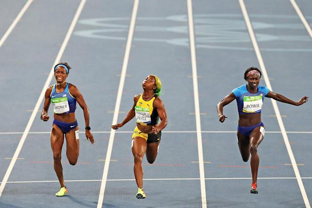 <p>English Gardner of the United States, Shelly-Ann Fraser-Pryce of Jamaica and Tori Bowie of the United States compete during the Women's 100m Final with on Day 8 of the Rio 2016 Olympic Games at the Olympic Stadium on August 13, 2016 in Rio de Janeiro, Brazil. (Photo by Cameron Spencer/Getty Images) </p>