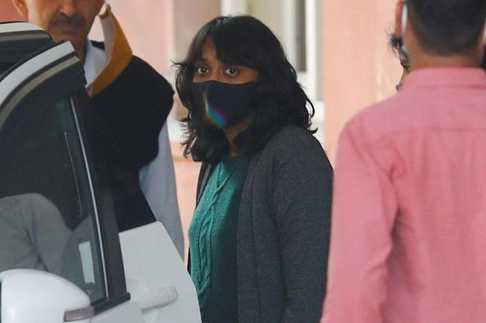 Disha Ravi, a 22-year-old climate activist, leaves after an investigation at National Cyber Forensic Lab, in New Delhi, India, February 23, 2021.
