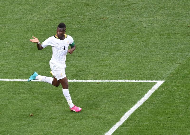 Ghana's forward and captain Asamoah Gyan celebrates after scoring a goal during the Group G football match between Portugal and Ghana at the Mane Garrincha National Stadium in Brasilia during the 2014 FIFA World Cup on June 26, 2014