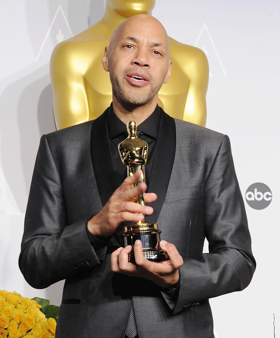 HOLLYWOOD, CA- MARCH 02: Screenwriter John Ridley, winner of Best Writing, Screenplay Based on Material Previously Produced or Published for '12 Years A Slave' poses in the press room during the 86th Annual Academy Awards at Loews Hollywood Hotel on March 2, 2014 in Hollywood, California.(Photo by Jeffrey Mayer/WireImage)