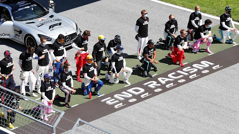 F1 drivers, pictured here taking a knee on the grid in support of the Black Lives Matter movement.