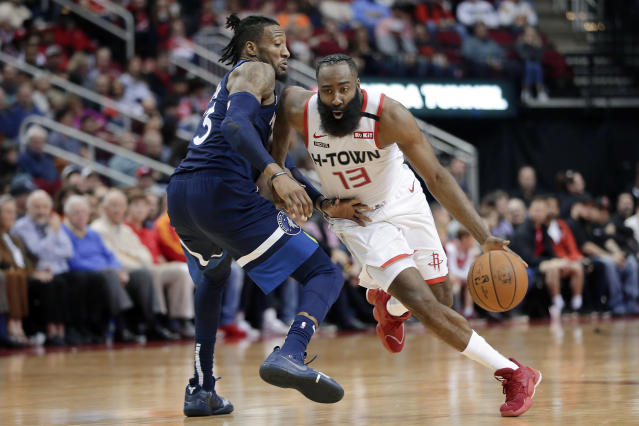 Houston Rockets guard James Harden (13) drives around Minnesota Timberwolves forward Robert Covington, left, during the second half of an NBA basketball game Saturday, Jan. 11, 2020, in Houston. (AP Photo/Michael Wyke)