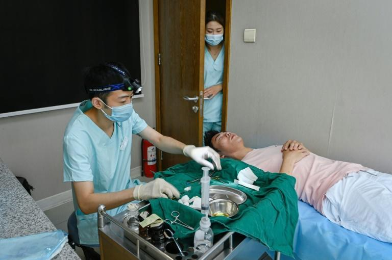 According to iResearch, around 17 percent of male white collar workers in China have had cosmetic treatments and the vast majority of men had their first procedure before the age of 30 (AFP/WANG ZHAO)