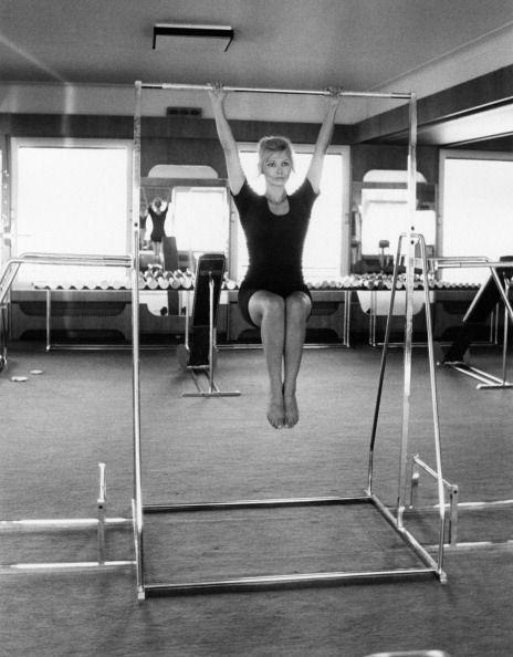 <p>Italian actress Scilla Gabel works out in a black leotard, a typical workout outfit of the decade. </p>