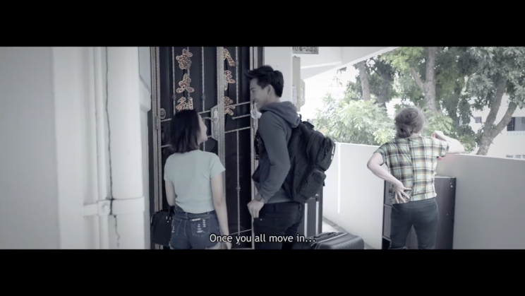 Screenshot of 'If Yishun were a movie' video: the couple moves into their apartment and is greeted by their new neighbour, a creepy old lady who is watering a bloody baby doll. (Photo: JUO Productions)