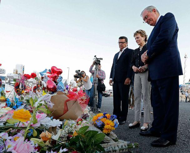 PHOTO: Juarez Mayor Armando Cabada, left, and El Paso Mayor Dee Margo, right, and his wife Adair, place flowers at the makeshift memorial outside the Walmart in El Paso, Texas, Aug. 7, 2019, where a mass shooting took place. (Larry W. Smith/EPA via Shutterstock)