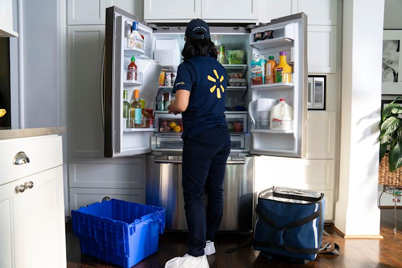 Walmart's InHome Delivery associates are trained on how to best organize a refrigerator.