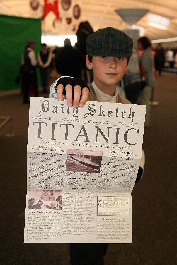 This handout photo released by the Titanic Memorial Cruises shows a child posing with a memorial newspaper in the departure lounge of the MS Balmoral cruise ship in Southampton on April 8. Passengers then plan to throw wreaths into the sea at 2:20 am about 800 kilometers (500 miles) southeast of Halifax at the time and place the ship sank. (AFP Photo/Simon Brooke-Webb)