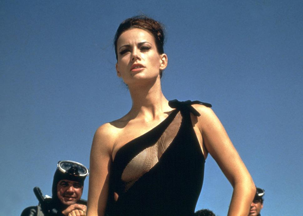 """DOMINIQUE """"DOMINO"""" DERVAL   MOVIE: <a href=""""http://movies.yahoo.com/movie/1800127497/info"""">Thunderball</a>  ACTRESS: <a href=""""http://movies.yahoo.com/movie/contributor/1800029561"""">Claudine Auger</a>  ALLEGIANCE: Mistress of SPECTRE agent, Emilio Largo.  LAST SEEN: Dangling from a sky hook.  SPECIAL SKILLS: Scuba diving, shooting villains with harpoons, first runner-up in Miss World Contest in 1958."""