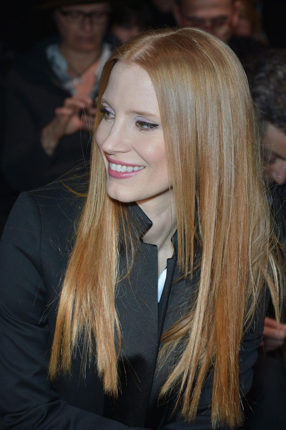 <p>Chastain wore her hair straight with a center part for 2013 Paris Fashion Week.</p>