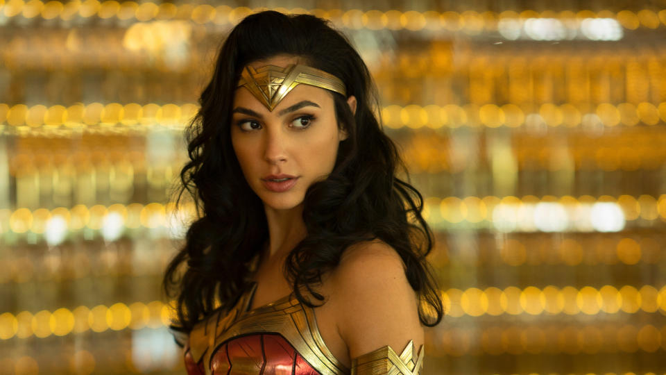 "Gal Gadot is back as the iconic Amazonian warrior as Patty Jenkins helms the sequel to her own previous movie – a rare shining spot in the gloom of the DC Extended Universe. This time, <a href=""https://uk.movies.yahoo.com/patty-jenkins-signs-record-breaking-222934414.html"" data-ylk=""slk:the First World War setting has been swapped for the 1980s;outcm:mb_qualified_link;_E:mb_qualified_link;ct:story;"" class=""link rapid-noclick-resp yahoo-link"">the First World War setting has been swapped for the 1980s</a>. (Credit: Clay Enos/Warner Bros)"