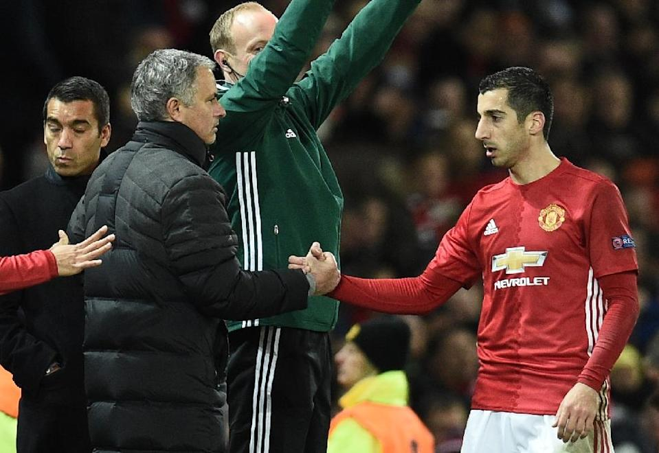 Manchester United's Henrikh Mkhitaryan (R) shakes hands with team manager Jose Mourinho as Mkhitaryan is substituted during a UEFA Europa League match in Manchester, in November 2016 (AFP Photo/Oli SCARFF )