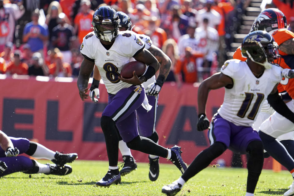 Baltimore Ravens quarterback Lamar Jackson (8) runs the ball against the Denver Broncos in the first half of an NFL football game Sunday, Oct. 3, 2021, in Denver. (AP Photo/Bart Young)