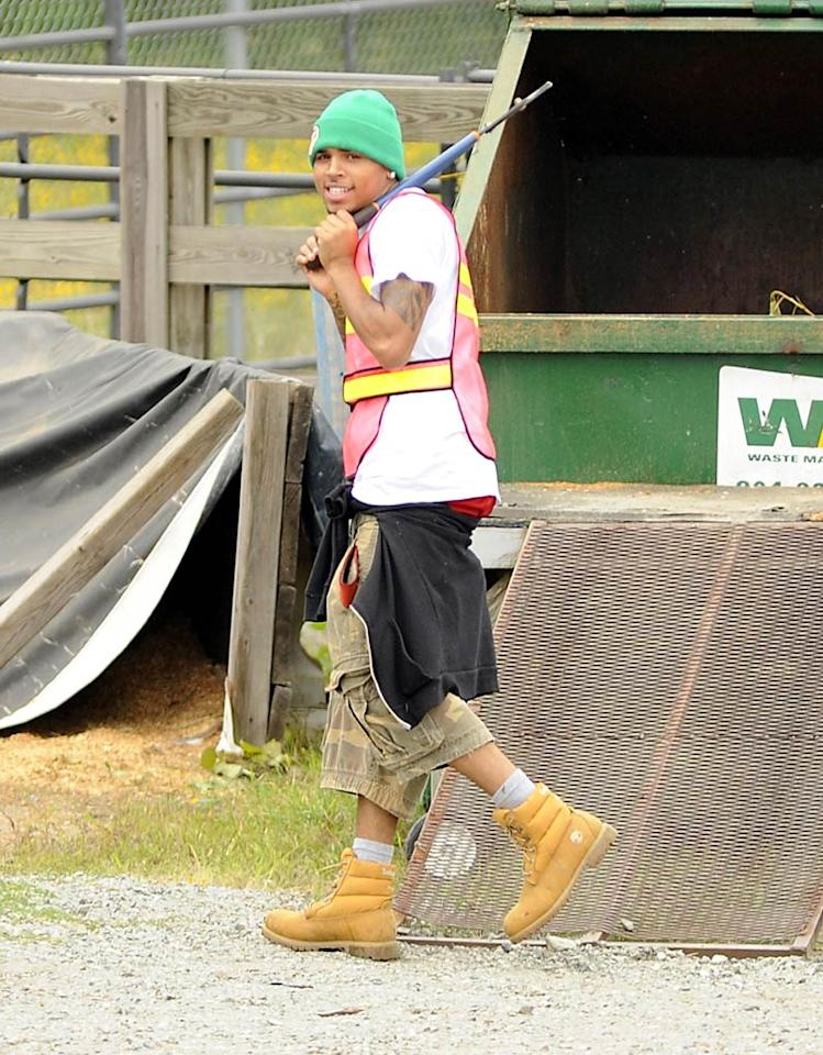 """While Pink was separating her shoulder, Chris Brown was separating litter from the landscape in Richmond, Virginia. The R&B singer must perform six months of community service as part of his conviction on felony assault charges. Gene Young/<a href=""""http://www.splashnewsonline.com"""" target=""""new"""">Splash News</a> - September 17, 2009"""