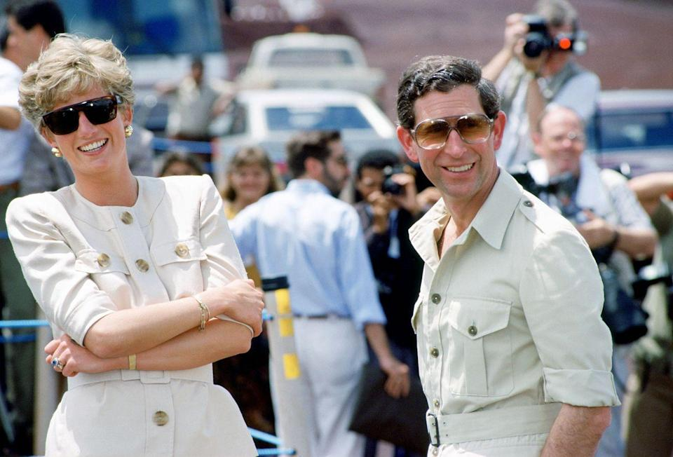 <p>Dressed alike, Diana and Charles visit a mining centre in Carajas, Brazil.</p>