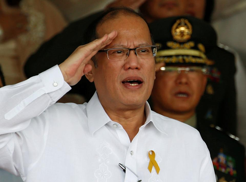 FILE PHOTO: Former President Benigno Aquino salutes during a military parade to honor him at the military's main Camp Aguinaldo in Quezon City a few days before he leaves office for President Rodrigo Duterte on June 27, 2016. (Source: REUTERS/Erik De Castro)