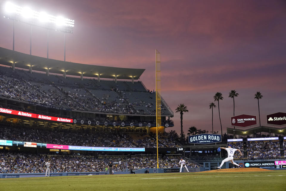 Los Angeles Dodgers starting pitcher Walker Buehler throws to a San Francisco Giants batter during the fourth inning of a baseball game Thursday, July 22, 2021, in Los Angeles. (AP Photo/Marcio Jose Sanchez)