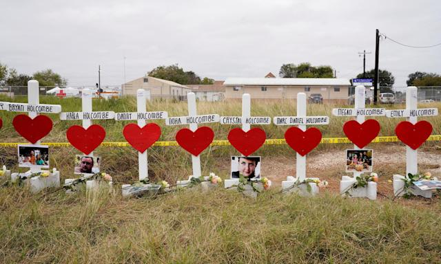A line of crosses seen on Nov. 9 in remembrance of the eight members of the Holcombe family killed in the shooting at the First Baptist Churchin Sutherland Springs, Texas. (Rick Wilking / Reuters)