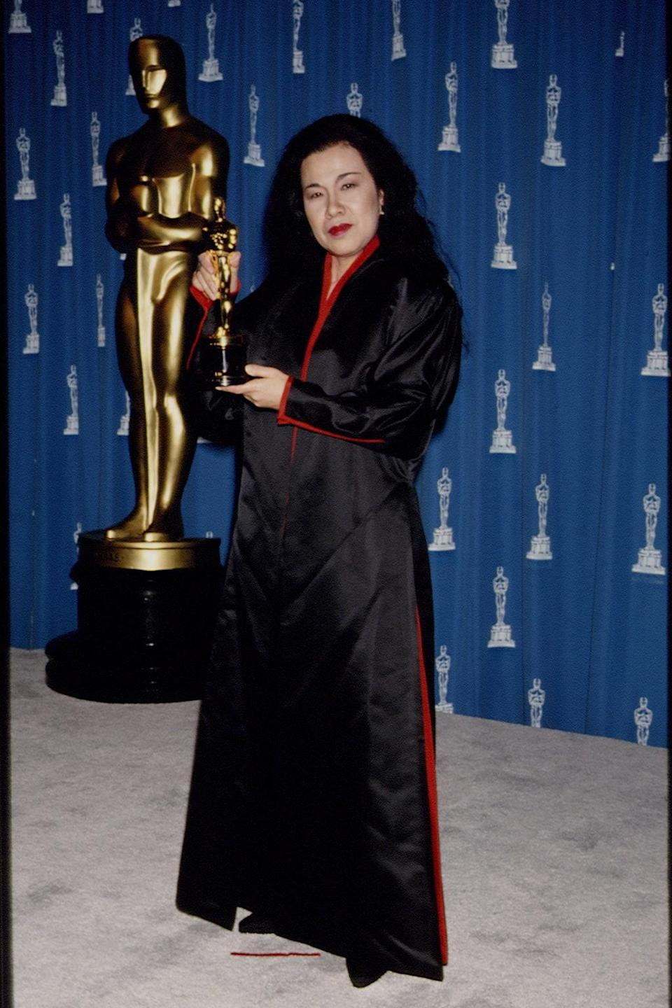 Nominated for best costume design for <em>Bram Stoker's Dracula</em> in 1993, the late Japanese costume designer's own outfit paid homage to the film (she won that night, too). Her black and red silk robe-dress mimicked the feel of Dracula's infamous red cape, but still read as elegant and appropriate for the Oscars evening dress code.