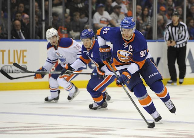 New York Islanders' John Tavares (91) drives the puck down ice followed by Kyle Okposo (21) and Edmonton Oilers' Mark Arcobello (26) in the second period of an NHL hockey game on Thursday, Oct. 17, 2013, in Uniondale, N.Y. (AP Photo/Kathy Kmonicek)