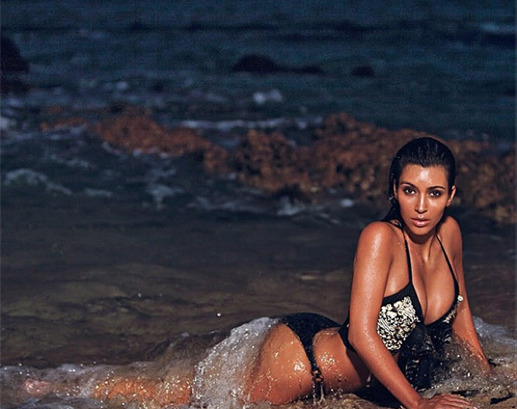 """<p class=""""MsoNoSpacing"""">Kim, who has tweeted 12,571 times to date, really likes to make her nearly 16 million fans jealous by sharing lots of vacation pics. On August 16, she posted another photo of her soaking wet and rolling around in the sand. </p>"""