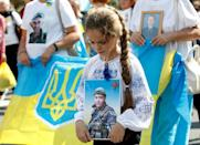 Relatives of Ukrainian servicemen killed in conflict in the eastern regions joined the parade