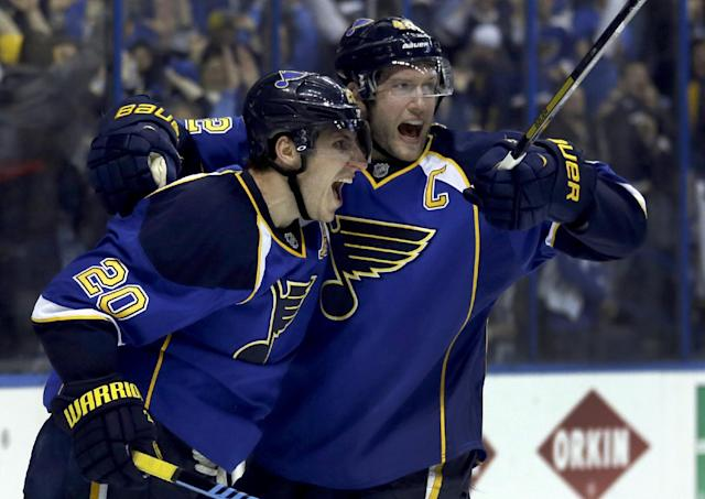 St. Louis Blues' Alexander Steen, left, is congratulated by teammate David Backes after scoring the game-winning goal during the third overtime in Game 1 of a first-round NHL hockey Stanley Cup playoff series against the Chicago Blackhawks Thursday, April 17, 2014, in St. Louis. The Blues won 4-3 in triple overtime. (AP Photo/Jeff Roberson)