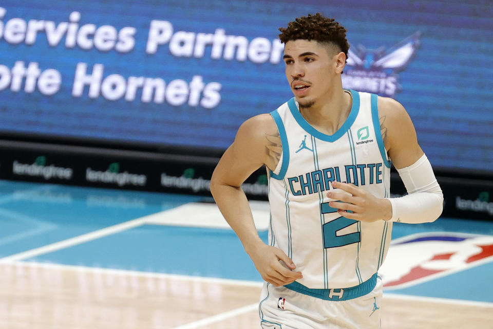 CHARLOTTE, NORTH CAROLINA - DECEMBER 12: LaMelo Ball #2 of the Charlotte Hornets looks on during the first half of their game at Spectrum Center on December 12, 2020 in Charlotte, North Carolina.